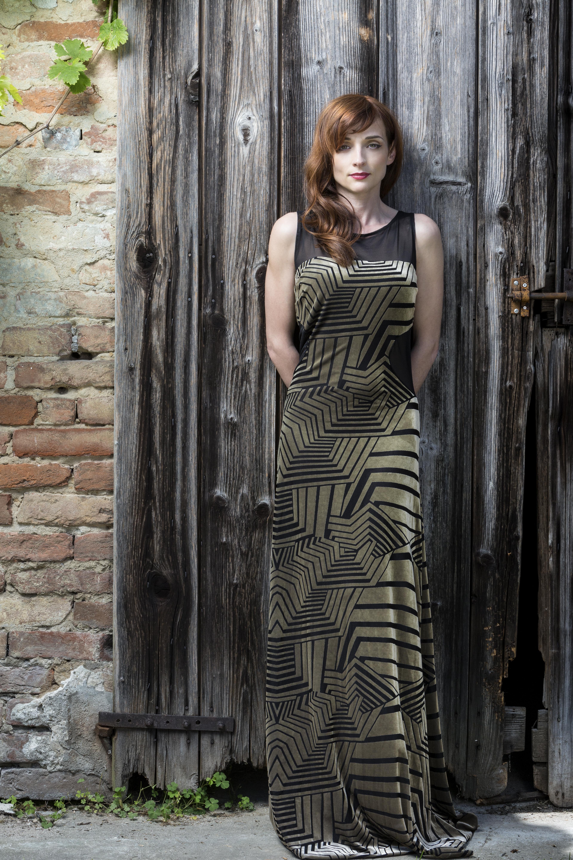 Floor length evening dress in golden velvet devore and black tulle cut outs