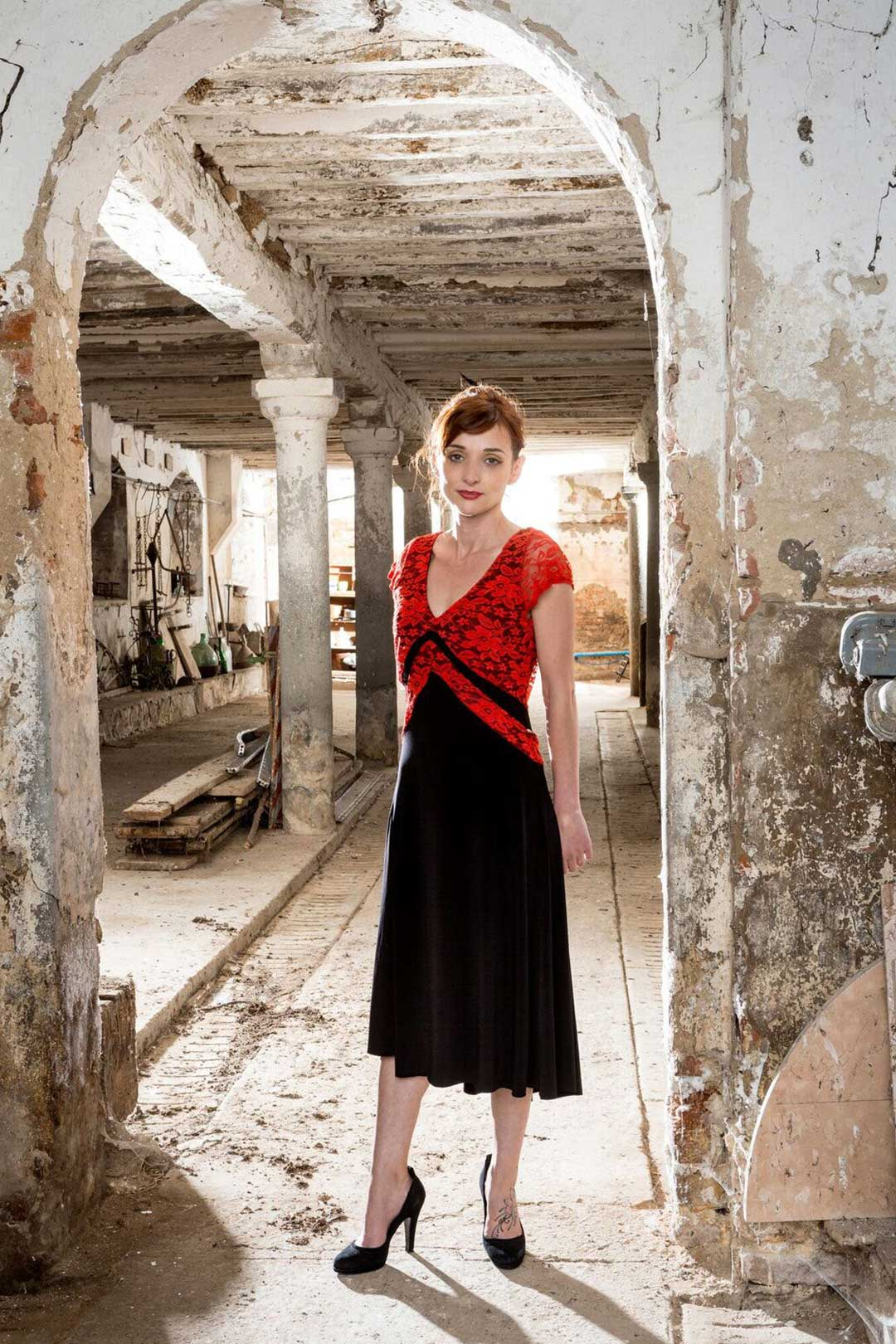 A front view of the V Argentine Tango dress with a black jersey and a red lace