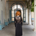slimming black Argentine tango dress with long sleeves tulle cut outs