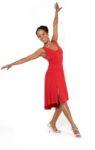 A woman dancing with her red Ferrari tango dress