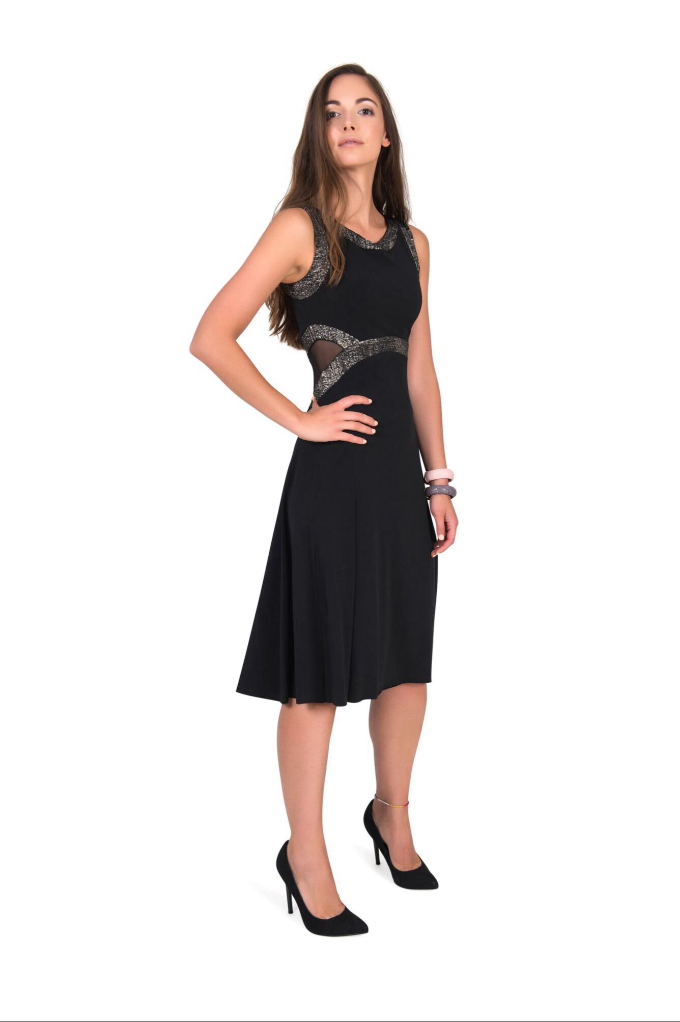 A woman elegantly wearing a black Tango dress