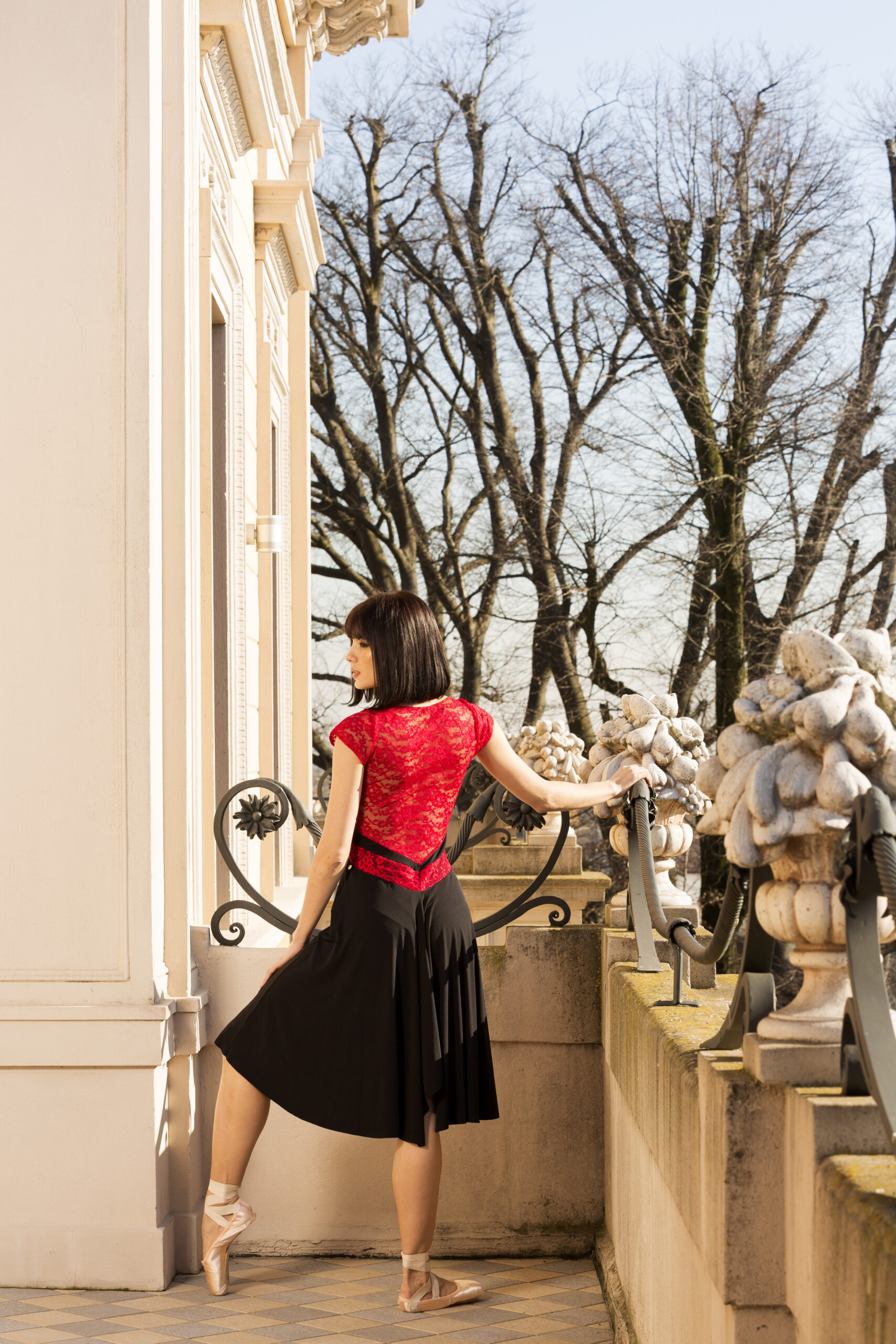 A back view of a V Argentine Tango dress with a red lace