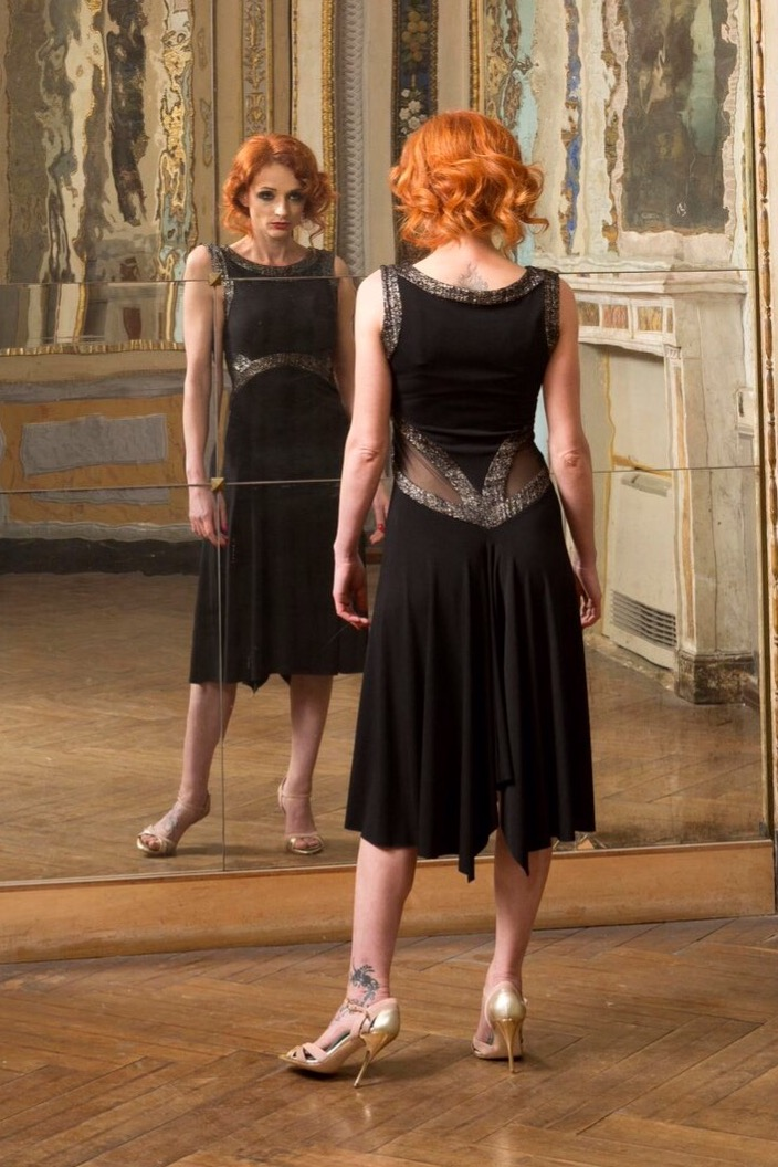 A woman looking at her reflection