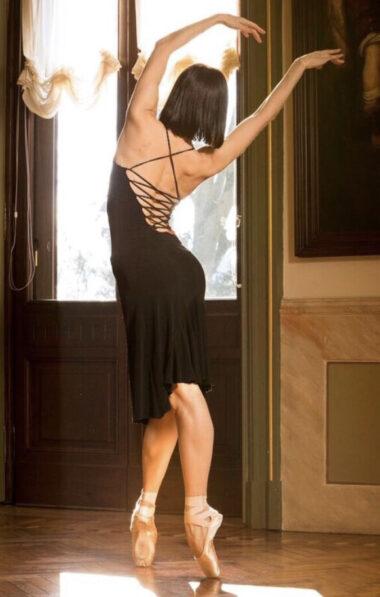 A dancer in a black Tango dress dancing