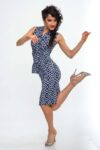 A dancer in motion while wearing an ortigia dress