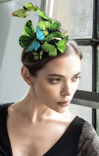A woman with butterflies on her hair