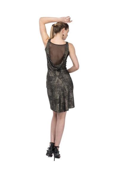 A bronze draped back dress