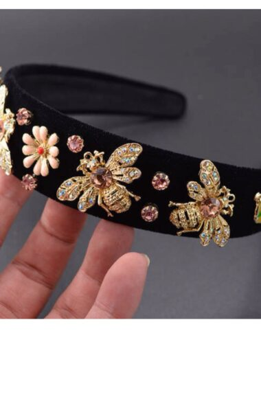 A headband with rhinestones and enamel
