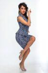 A dancer posing while wearing an ortigia dress