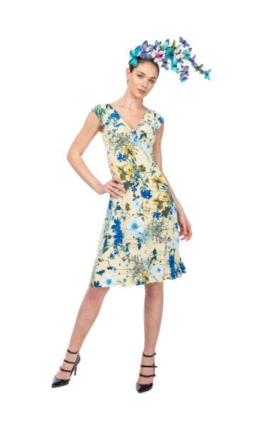 A woman wearing a blue floral Tango dress