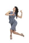 A dancer wearing a patterned ortigia dress