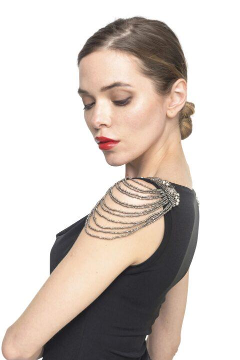 A close-up portrait draped neckline tango top