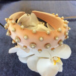 Gorgeous padded headband in velvet with handmade rhinestones and pearls decorations.
