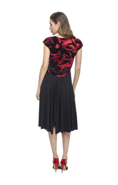 A woman wearing a red patterned Tango dress